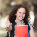 stock-photo-21282541-beautiful-young-student-with-thumb-up